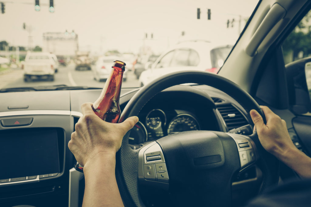 driving while holding beer bottle