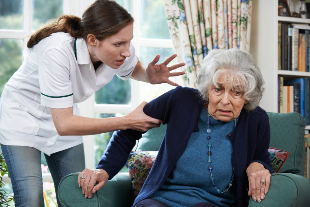 lady yelling at elderly woman