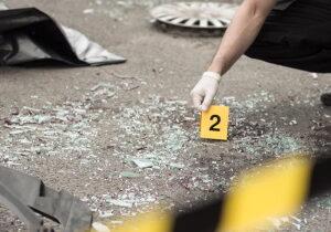 Officer at crash scene at-fault car insurance concept