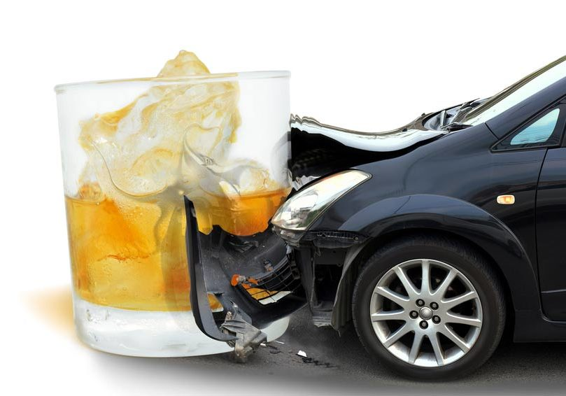 A drunk driving crashing and a glass of liquor.
